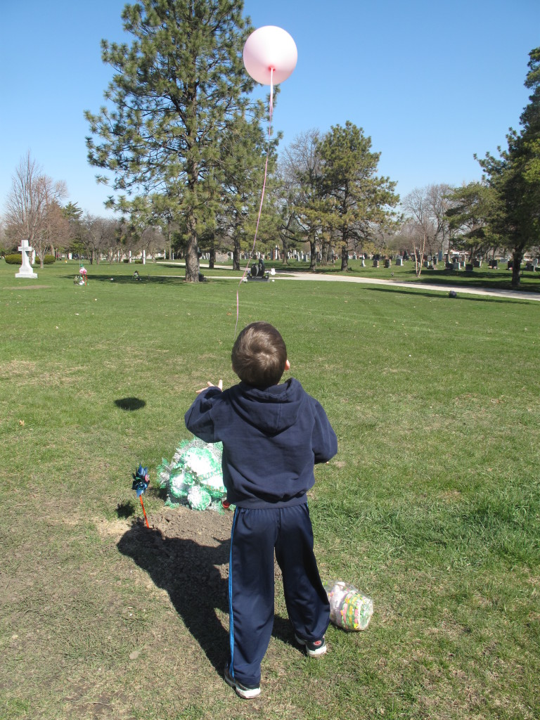 Sean releasing a pink balloon on Molly's 1st Heavenly Birthday (April 2009)